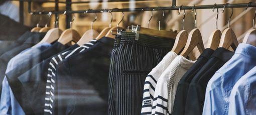 Photo of cotton pants and shirts on racks