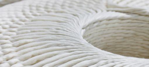 A closeup photo of a white cotton yarn