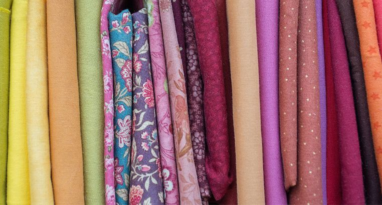 Photo of different colored-cotton fabrics from yellow to