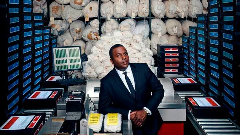 African-American guy in an office with cotton in the background