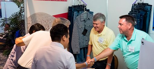 5 people at a COTTON USA event, 2 people shaking hands