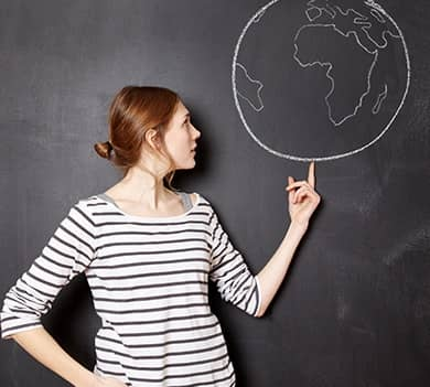 woman looking at  planet drew in a black chalk board